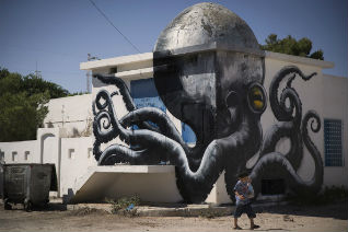 ROA's giant octopus mural. (Image credit: JOEL SAGET/AFP/Getty Images)